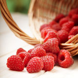 Strawberries in a basket on the table stock photos