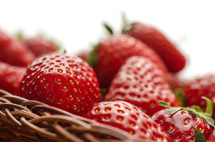 Strawberries in basket on white background Royalty Free Stock Images