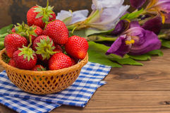 Strawberries in the basket on wooden background Royalty Free Stock Photography