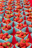 Strawberries in baskets on display Stock Image