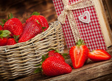 Strawberries. Beautiful strawberries with cookbook on wooden table stock photography