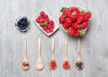 Strawberries, berries and raspberries on rustic wooden table Stock Image