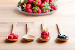 Strawberries, berries and raspberries on rustic wooden table Stock Images