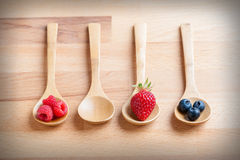 Strawberries, berries and raspberries on rustic wooden table Royalty Free Stock Images