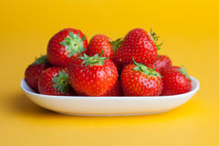 Strawberries berry  on yellow background. Stock Image
