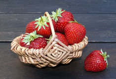 Strawberries. Big strawberries in a small basket Stock Photos
