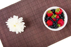 Strawberries, bilberry and flower Royalty Free Stock Image