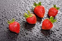Strawberries on black background Royalty Free Stock Photography