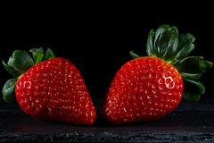 Strawberries. With black background and brightness Royalty Free Stock Images