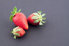 Strawberries. In a black bowl on a white background Royalty Free Stock Photography