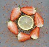 Strawberries, black peppercorns, chili, lemon Royalty Free Stock Image