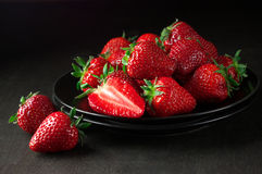 Strawberries in black plate Royalty Free Stock Image