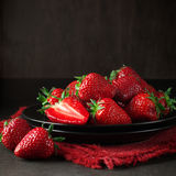 Strawberries in black plate Royalty Free Stock Images