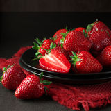 Strawberries in black plate Royalty Free Stock Photography