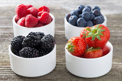 Strawberries, blackberries, raspberries and blueberries in bowls Royalty Free Stock Photography