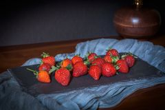 Strawberries on blackboard royalty free stock images