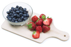Strawberries and blue berries Royalty Free Stock Images
