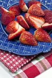 Strawberries on blue plate Stock Images