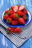 Strawberries in blue plate Royalty Free Stock Photo