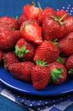 Strawberries in blue plate Royalty Free Stock Images