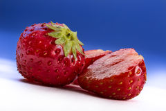 Strawberries on blue and white background Royalty Free Stock Image