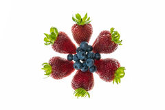 Strawberries and blueberries arranged in circle on white background Royalty Free Stock Photos