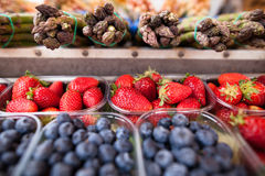 Strawberries, blueberries and asparagus Stock Images