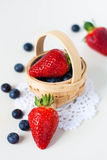 Strawberries and blueberries  in a basket Royalty Free Stock Photos