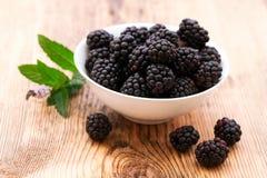 Strawberries, blueberries, blackberries and. Raspberries in bowls, top view, close-up Stock Photos