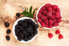 Strawberries, blueberries, blackberries and. Raspberries in bowls, top view, close-up Royalty Free Stock Photography