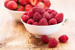 Strawberries, blueberries, blackberries and. Raspberries in bowls, top view, close-up Royalty Free Stock Images