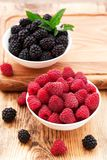 Strawberries, blueberries, blackberries and. Raspberries in bowls, top view, close-up Royalty Free Stock Photo