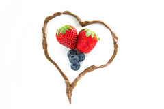 Strawberries and Blueberries in a Chocolate Heart Stock Photo