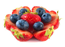 Strawberries with blueberries in circle.. On white background Royalty Free Stock Images