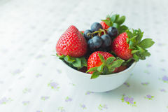 strawberries and blueberries Stock Photos