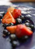 Strawberries and blueberries on a dessert plate Stock Images