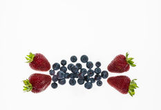 Strawberries and blueberries isolated on white background Royalty Free Stock Photography