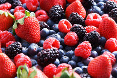 Strawberries, blueberries, raspberries and black berries. Fresh berries on white background Stock Photos