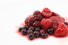 Strawberries, blueberries and raspberries isolated on White Bac. Strawberries, blueberries and raspberries with syrup  isolated on White Background Stock Photo