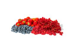 Strawberries, blueberries, red currants and raspberries. Berry fruits like strawberries, blueberries, red currants and raspberries in a bunch royalty free stock photos