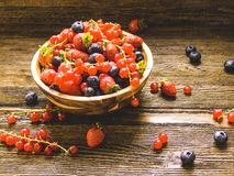 Berries with rustic wooden background Stock Photos