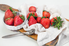 Strawberries on board cutting on striped napkin Stock Photography