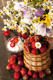 Strawberries and bouquet Stock Photos