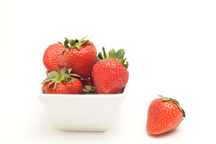 Strawberries in a bowl. Photograph of strawberried in a bowl,shot in studio against a white background Royalty Free Stock Photos