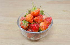 Strawberries in a bowl with background Stock Image