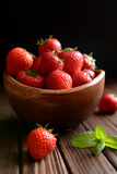 Strawberries in a bowl on black background Royalty Free Stock Images