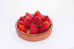Strawberries. Strawberries in a bowl of mud stock photography