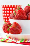 Strawberries in bowl Stock Photos