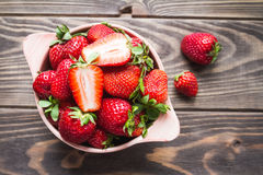 Strawberries in a bowl on a old table royalty free stock photo