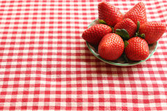 Strawberries. A bowl of Strawberries on a red and white gingham tablecloth Stock Photography
